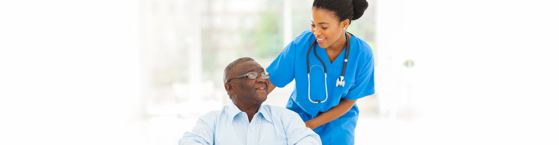 nurse and senior man looking at each other
