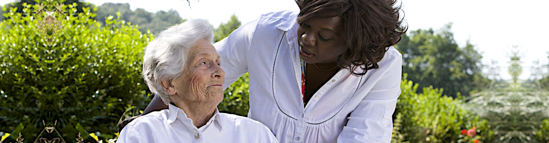 caregiver and senior woman looking at each other